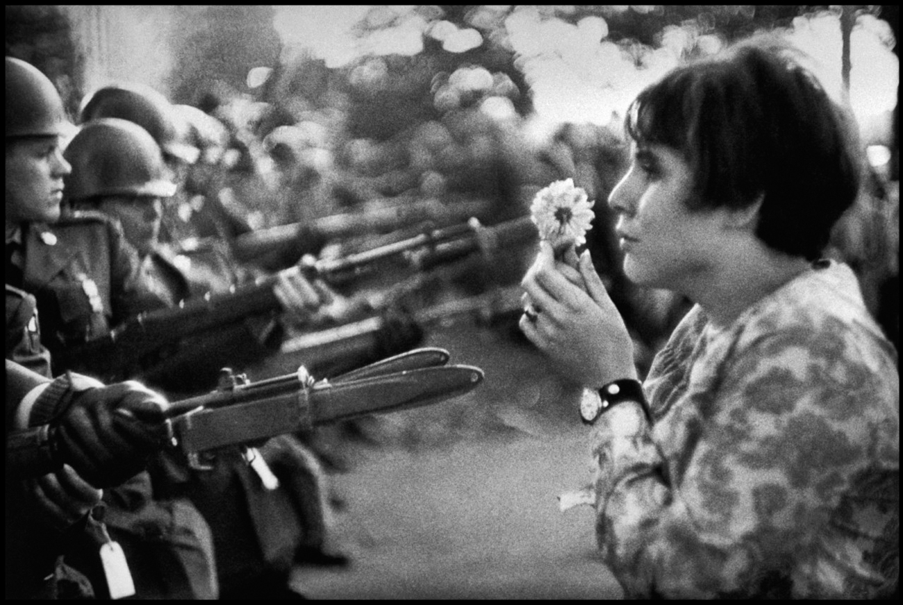Marc Riboud. Washington DC. 1967. An American young girl, Jan Rose KASMIR, confronts the American National Guard outside the Pentagon during the 1967 anti-Vietnam march. This march helped to turn public opinion against the US war in Vietnam. Image from magnumphotos.com