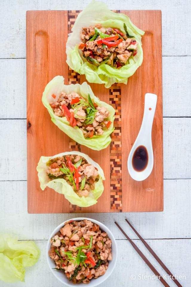 Three healthy chicken lettuce wraps with ground chicken wrapped in butter lettuce.