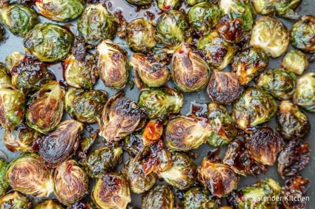 Crispy Asian Brussels sprouts with sticky sauce, garlic, and red pepper flakes.