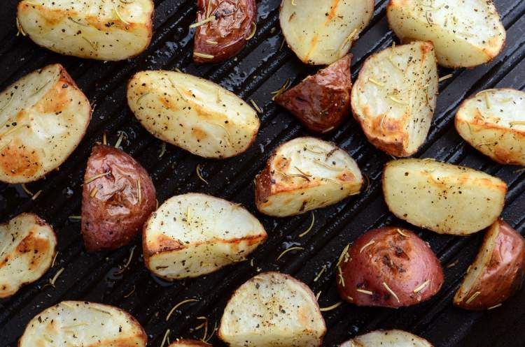 Grilled Red Potatoes on a grill pan with spices.