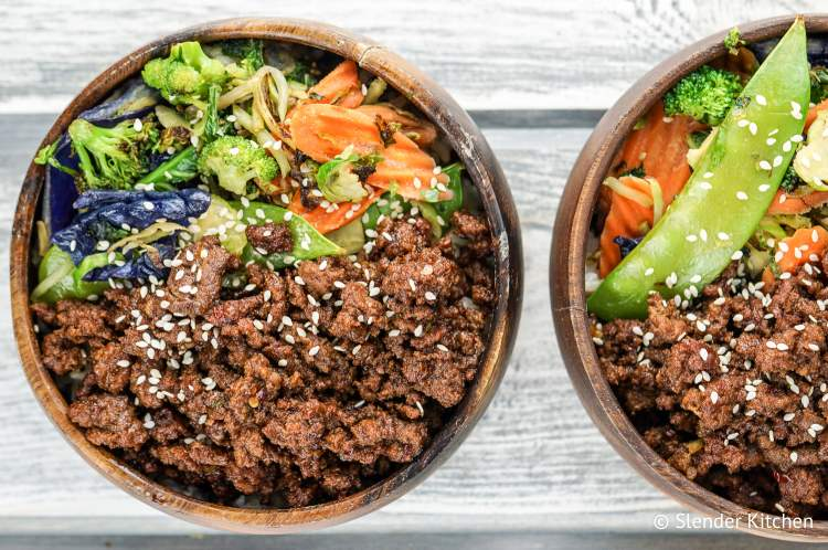 Korean beef with vegetables in wooden bowls.