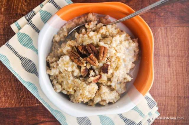 Make ahead steel cut oats in a bowl with walnuts and almond milk.