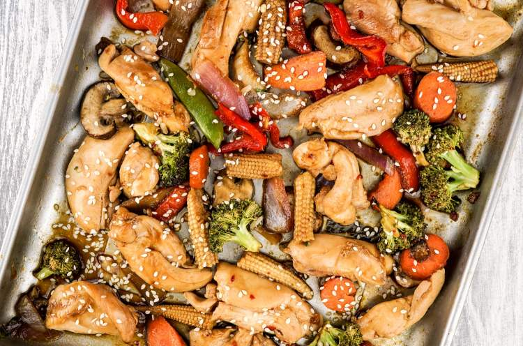 Asian Chicken Stir Fry on a sheet pan.