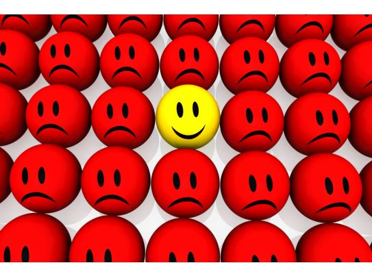 Yellow Happy Smiley Among Red Unhappy Smileys Stock Photo