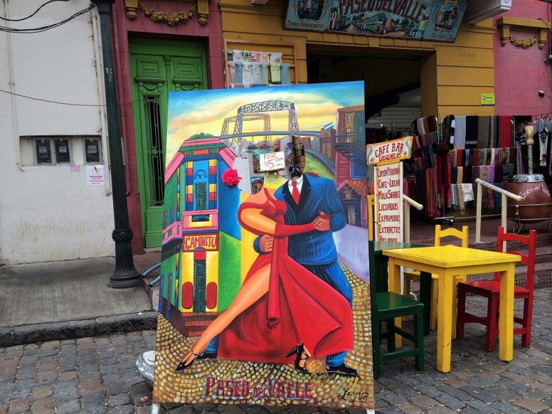 anyone is welcomed to take a picture with cardboard tango dancers (with head cutouts) for a fee; real dancers entertain patrons in restaurants