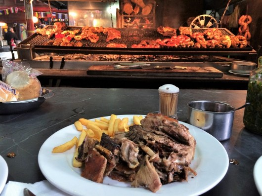 Week 9: Montevideo - more meat! At Puerto del Mercado, you can just pull up at seat at the meat bar and order whatever you see!
