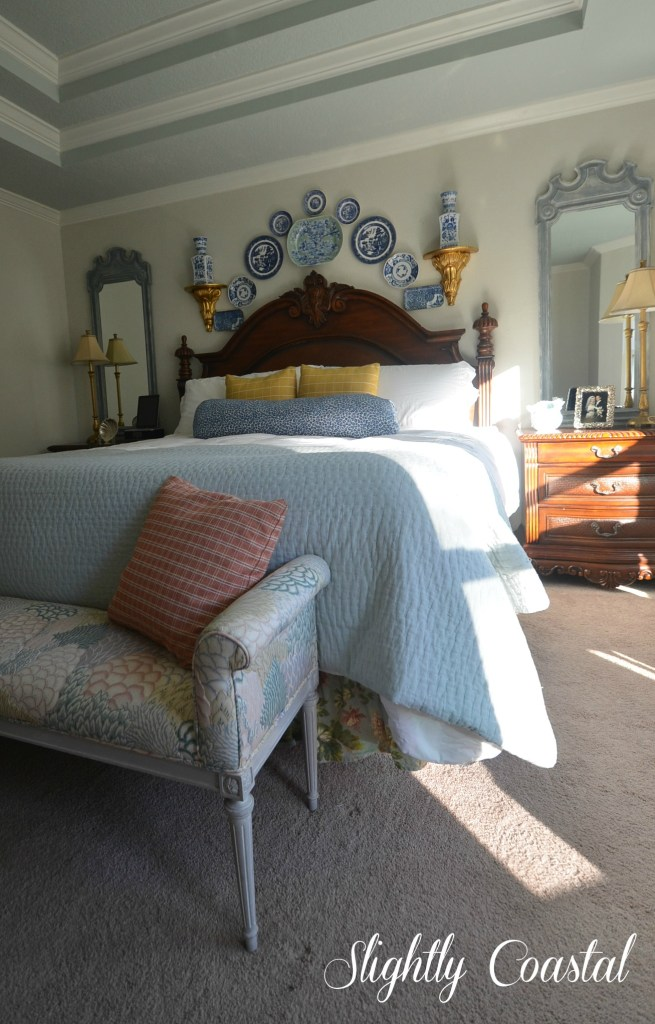 Master Bedroom With Blue and White Plate Wall. Slightly Coastal