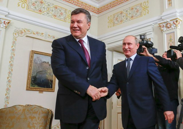 Russia's President Vladimir Putin (R) shakes hands with his Ukrainian counterpart Viktor Yanukovich at the Novo-Ogaryovo residence outside Moscow in this October 22, 2012 file photo. When Yanukovich rejected a trade pact with the European Union and turned to Moscow, he put off painful, EU-prescribed economic surgery that could have hurt his re-election prospects. But he disappointed entrepreneurs who had hoped the EU deal would bring long-term growth by giving them easier access to rich markets and pushing Kiev harder to pursue policies - from cutting red tape and graft to tightening state budgets - that the IMF says would make post-Soviet Ukraine more competitive.        To match UKRAINE-EU/ECONOMY        REUTERS/Sergey Ponomarev/Pool/Files (RUSSIA - Tags: POLITICS BUSINESS)