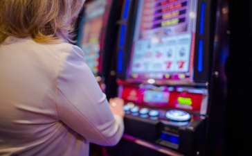 Woman playing on slot machine
