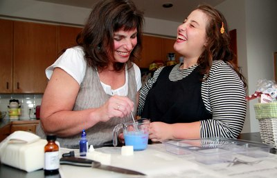 Anna and me photographed making soap
