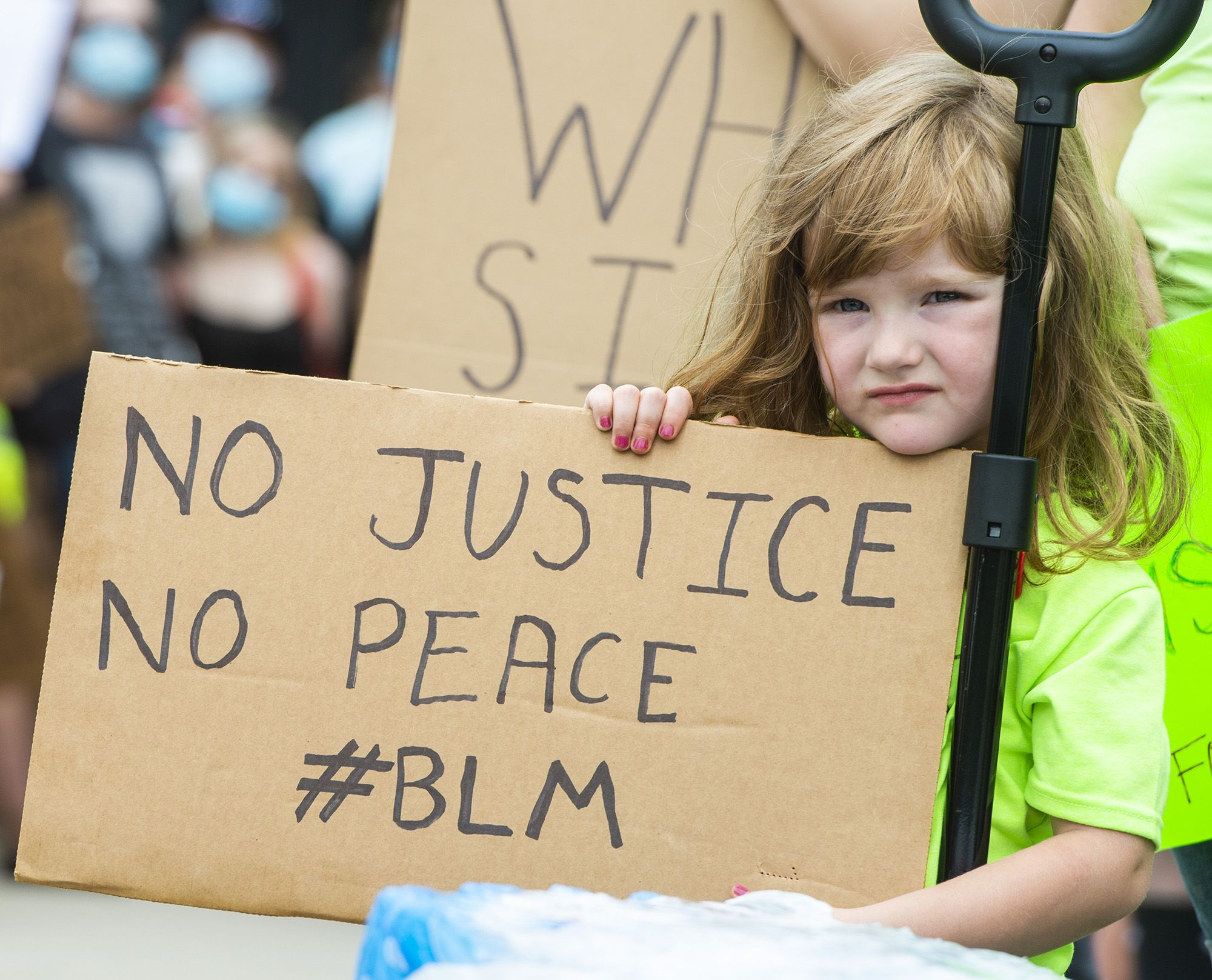 (Rick Egan  |  The Salt Lake Tribune)  Aston Park, 4, holds a sign as she helps her mother hand out water, as hundreds of  protesters gather on Capitol Hill, during a George Floyd, demonstration in Salt Lake City on Thursday, June 4, 2020.