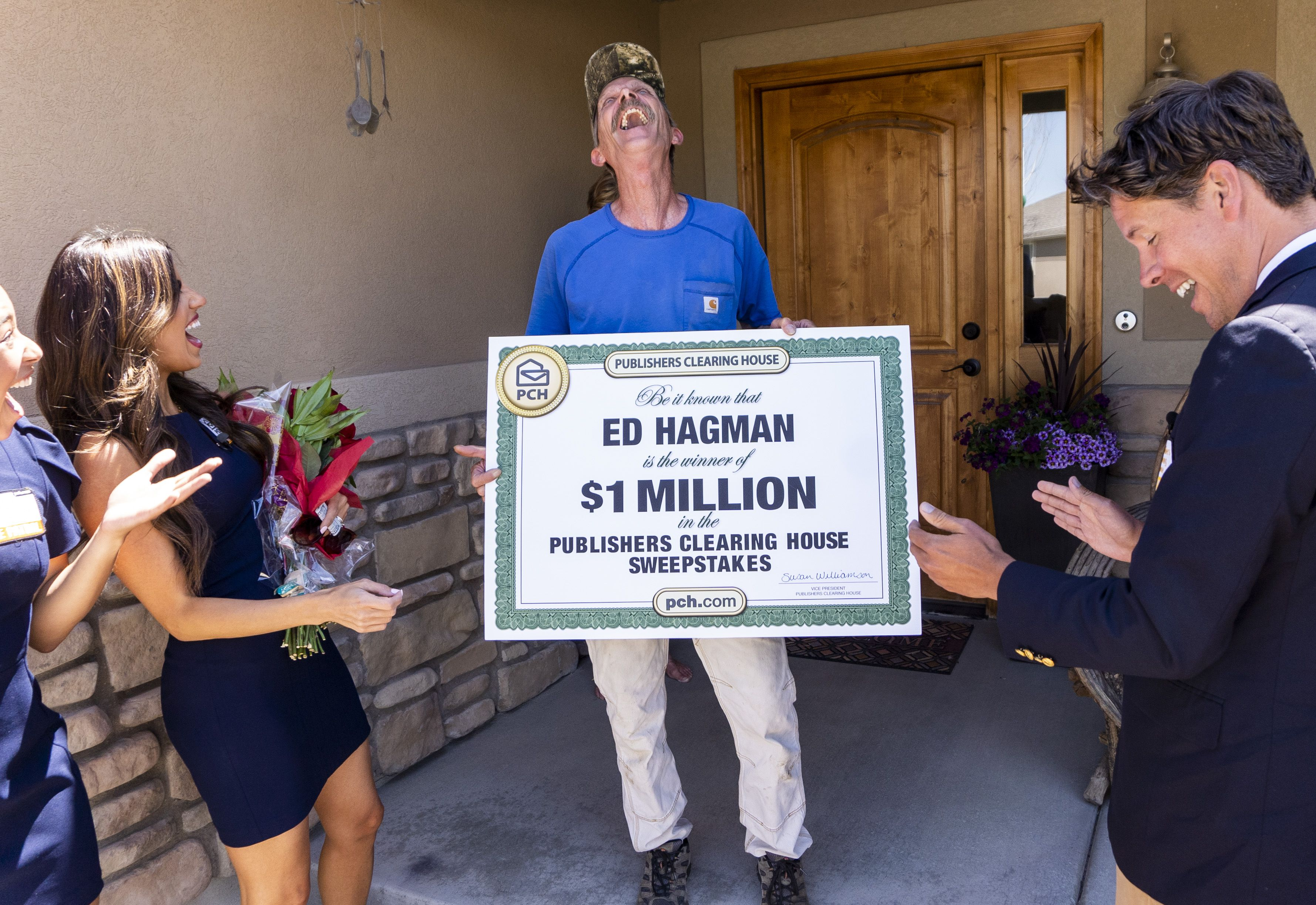 (Rick Egan | The Salt Lake Tribune) Members of the Prize Patrol from Publishers Clearing House, from left,  Bianca Quinnonez, Danielle Lam and  Howie Guja surprise Ed Hagman (center) with the news that he won $1,000,000, at his home in Herriman, on Friday, May 28th