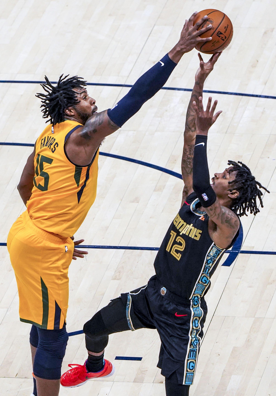 (Leah Hogsten   The Salt Lake Tribune)  Utah Jazz center Derrick Favors (15) denies Memphis Grizzlies guard Ja Morant (12) as the Utah Jazz host the Memphis Grizzlies, Mar. 27, 2021 at Vivint Arena.