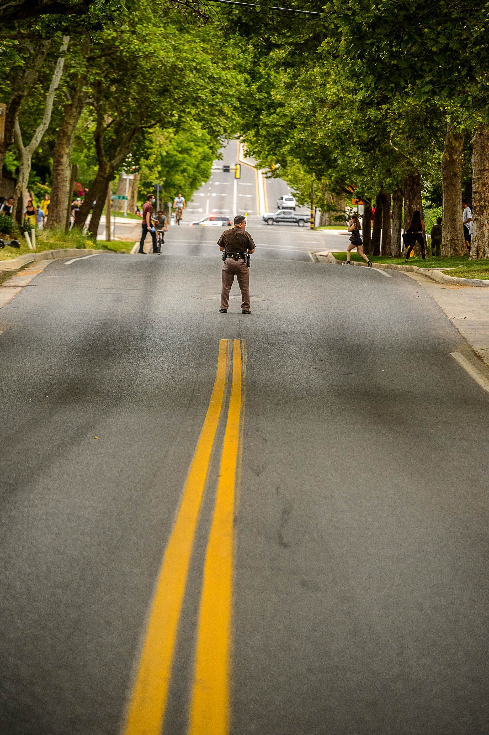 (Trent Nelson  |  The Salt Lake Tribune) A Utah Highway Patrol trooper stands in the middle of State Street as protesters rally against police brutality at the State Capitol in Salt Lake City on Thursday, June 4, 2020.
