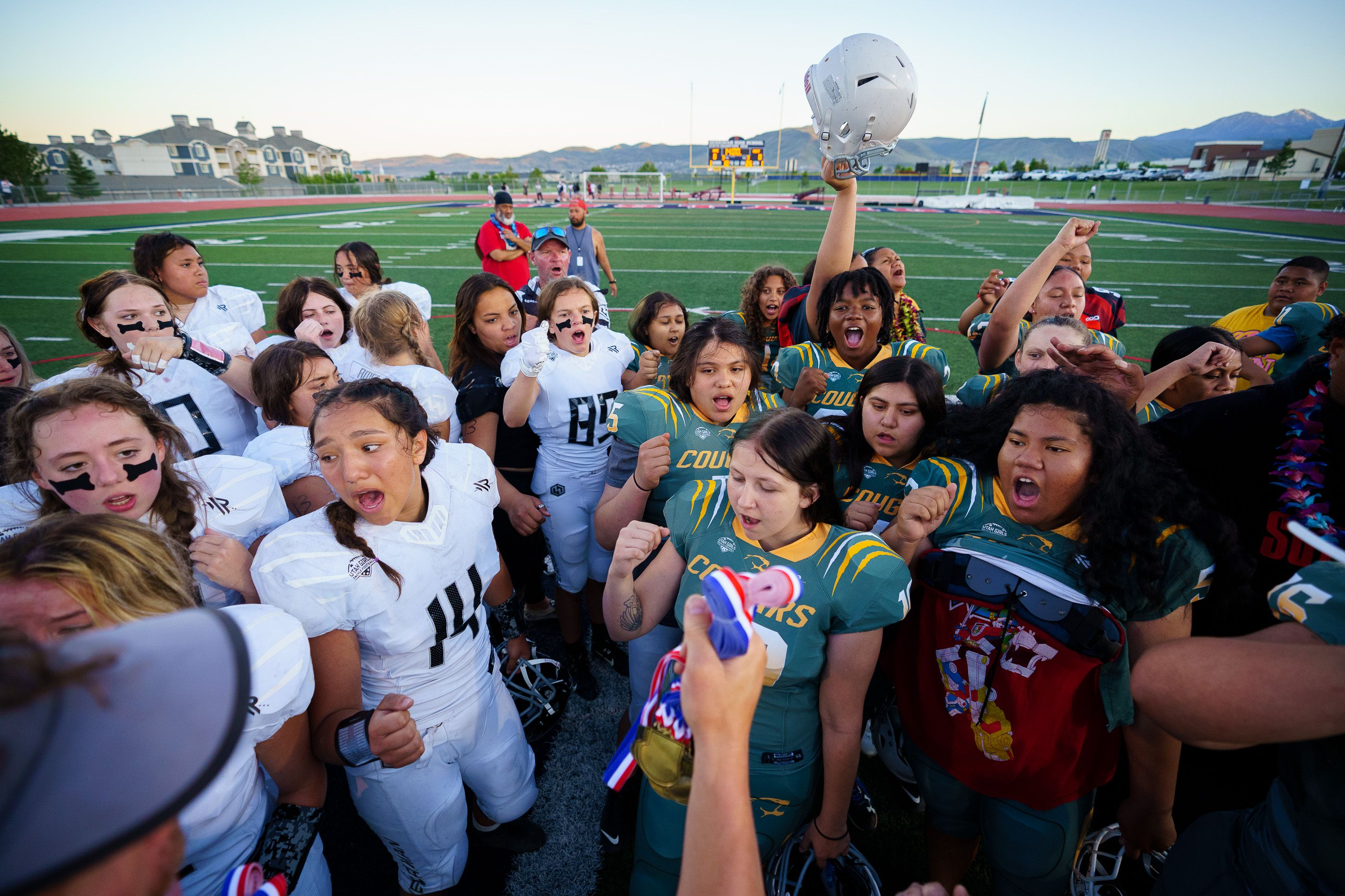 (Trent Nelson     The Salt Lake Tribune)  Players from Herriman and Kearns gather after their game in the Utah Girls Tackle Football League Division 3 championship game at Herriman High School on Thursday, May 27, 2021.