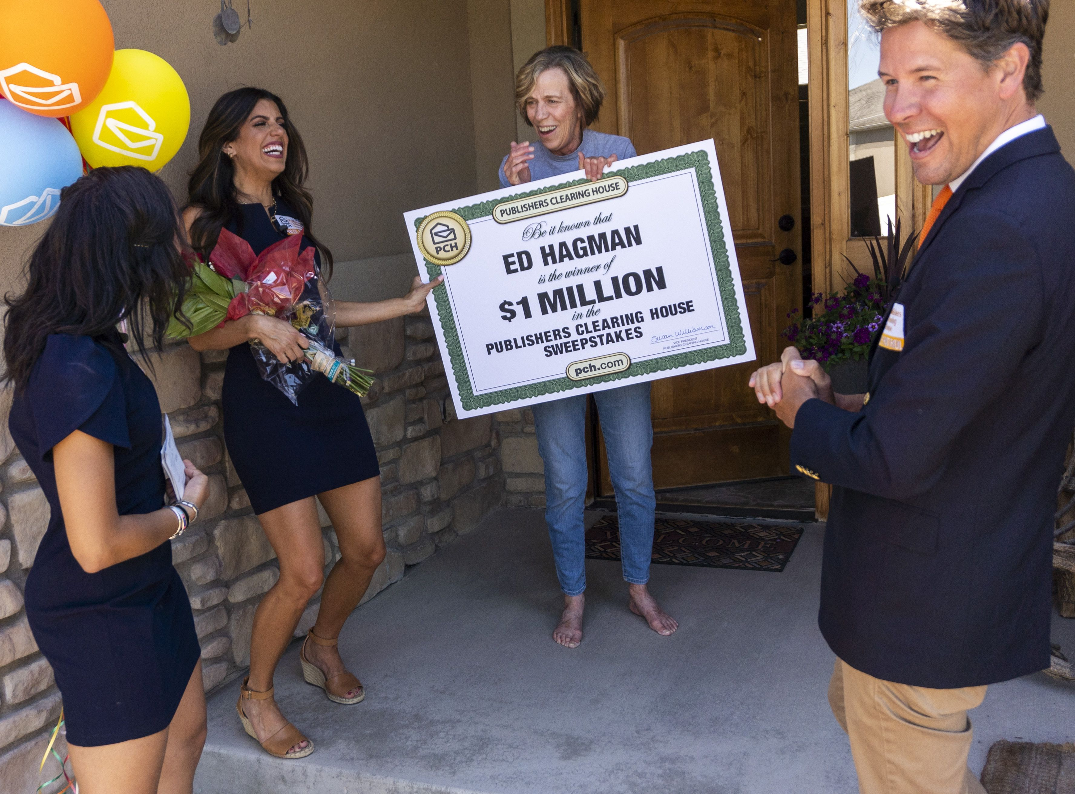 (Rick Egan | The Salt Lake Tribune) Members of the Prize Patrol from Publishers Clearing House, from left,  Bianca Quinnonez, Danielle Lam and  Howie Guja surprise Denise Hagman (center) with the news that she and her husband won $1,000,000, at her home in Herriman, on Friday, May 28th