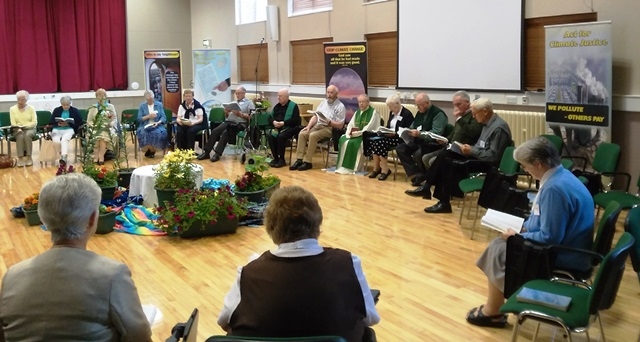 Participants at the Summer School share Eucharist with Fr. Donal Dorr