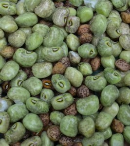 Shelled-out peas, some green and some brown