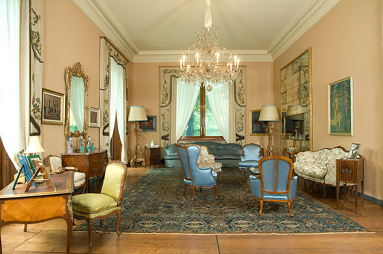 (above) the grand salon as it appears today with the former owners' personal design choices (photo by Giorgio Majno)