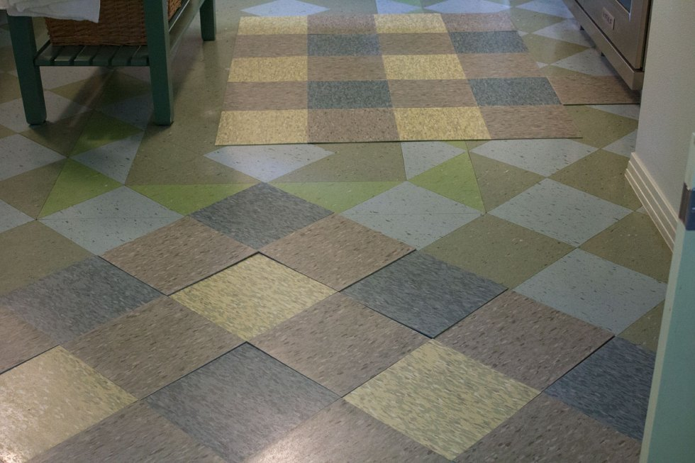 This plaid/checkered pattern was the chosen option. The diagonal version, seen in the foreground, is the chosen direction the tiles are to be laid. The tile is Tarkett Azrock VCT.