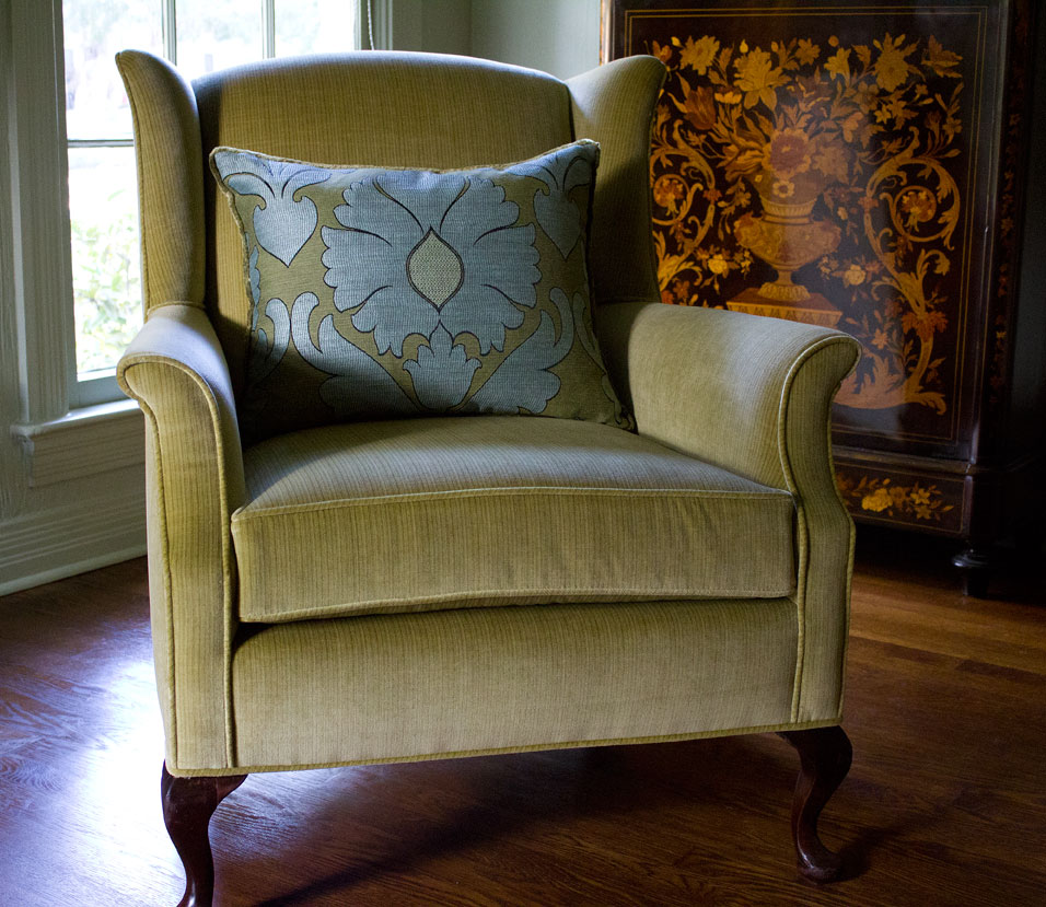 Click on the photo for a larger version, and then you will be able to see the tiny stripe detail of the chair's upholstery.