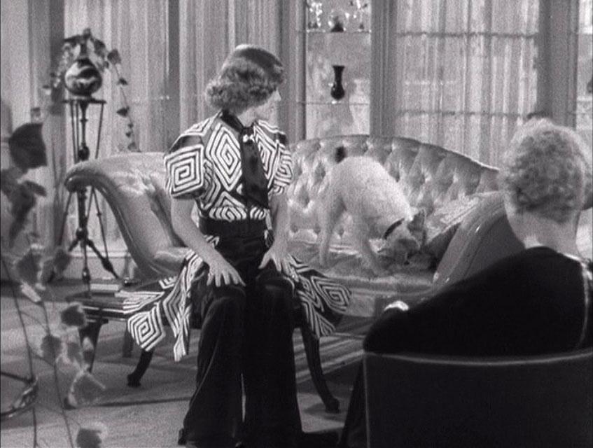 (above) Smith looks for treats on the family sofa—the satin tufted sofa.
