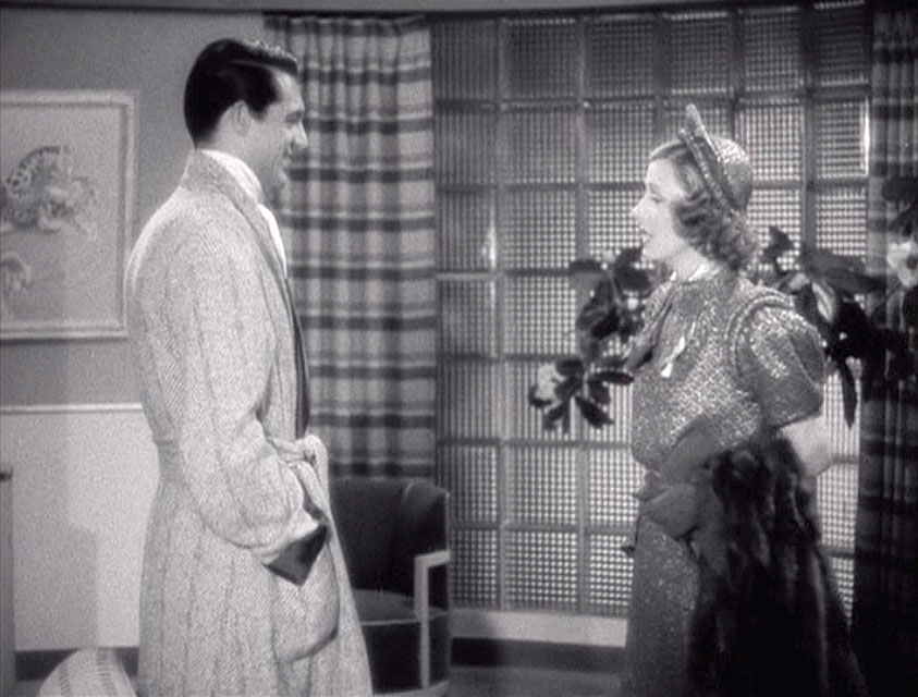 (above) Common features in manly apartments in these old films are glass-block walls, plaid or striped curtains, and low partitions with built-in seating.