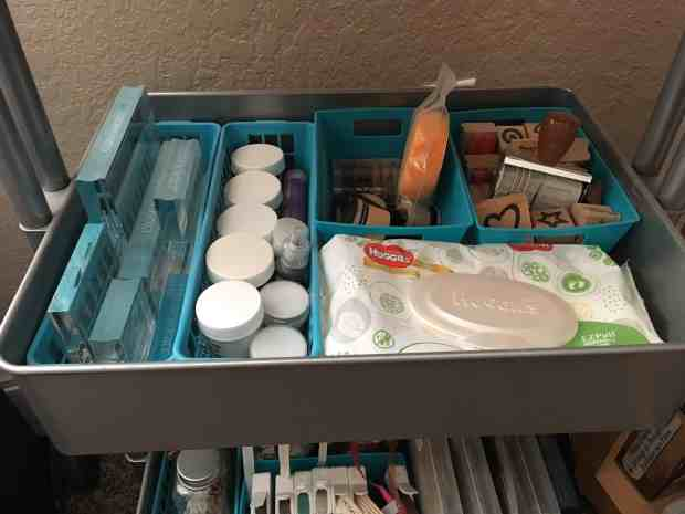 Rolling Cart Organization - Middle shelf with clear stamping blocks, wooden stamps, cleaning wipes, stamp daubers, embossing powders
