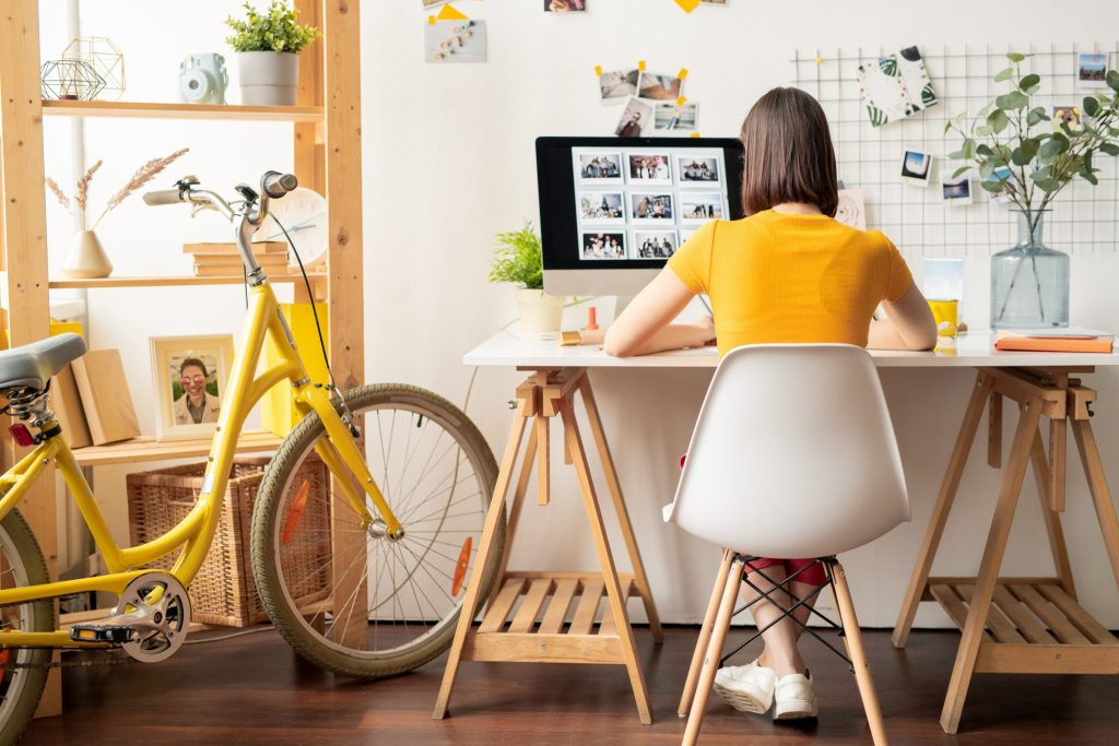 A woman works in a home office.