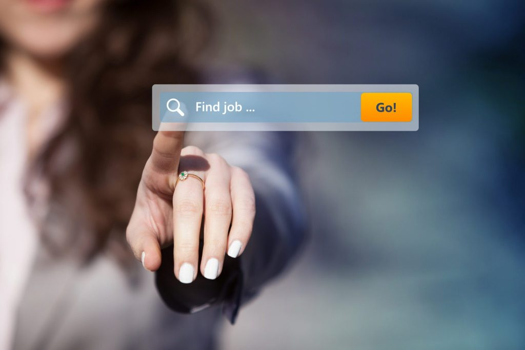 A woman is poitning at a screen that says job search.