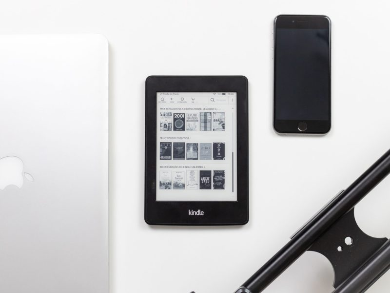 black Amazon Kindle e-book reader on white surface