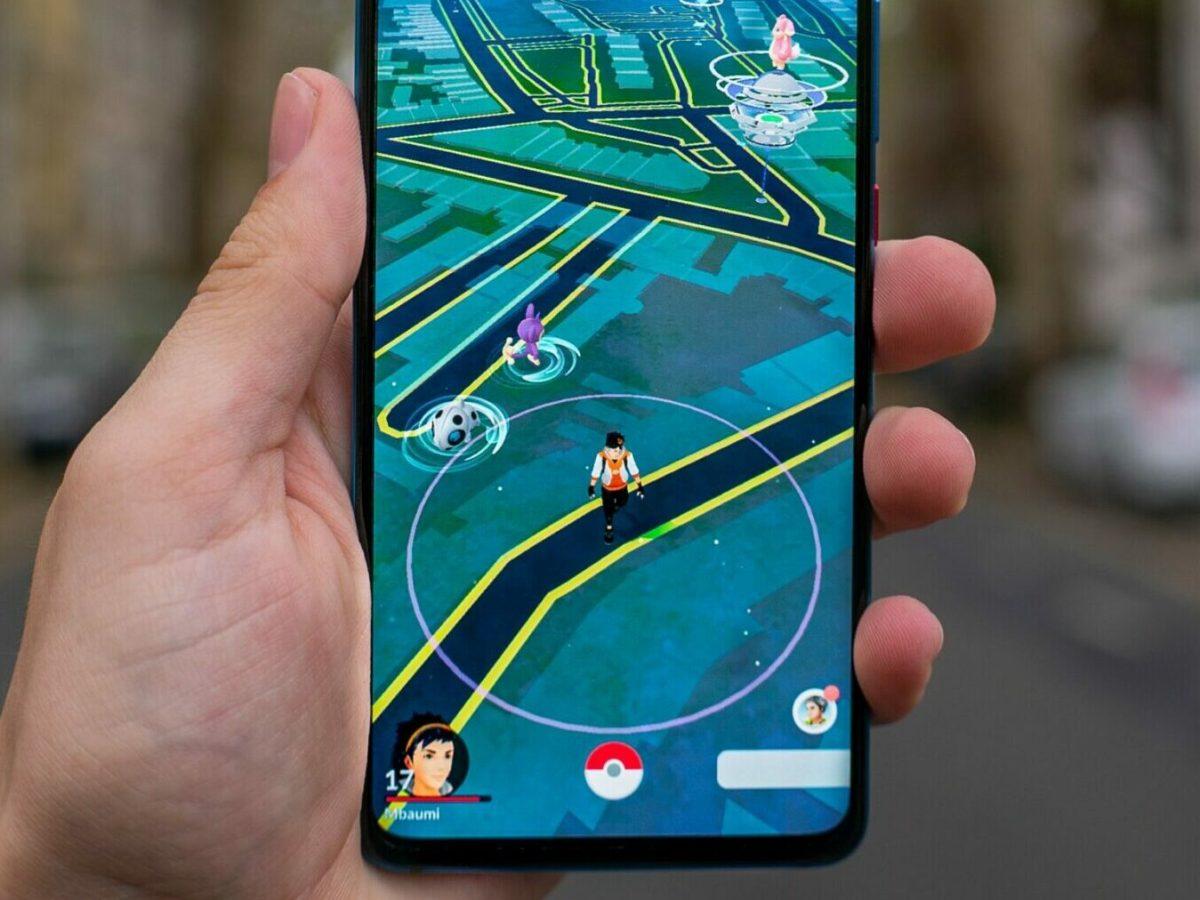 person holding black android smartphone pokemon go