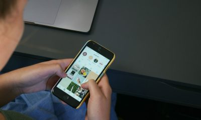 person using iPhone instagram feed