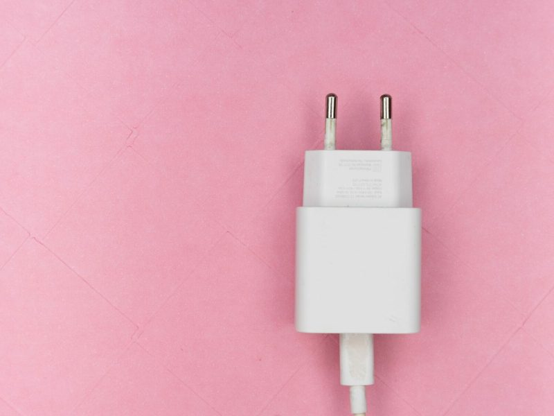 white usb smartphone charger adapter on pink surface