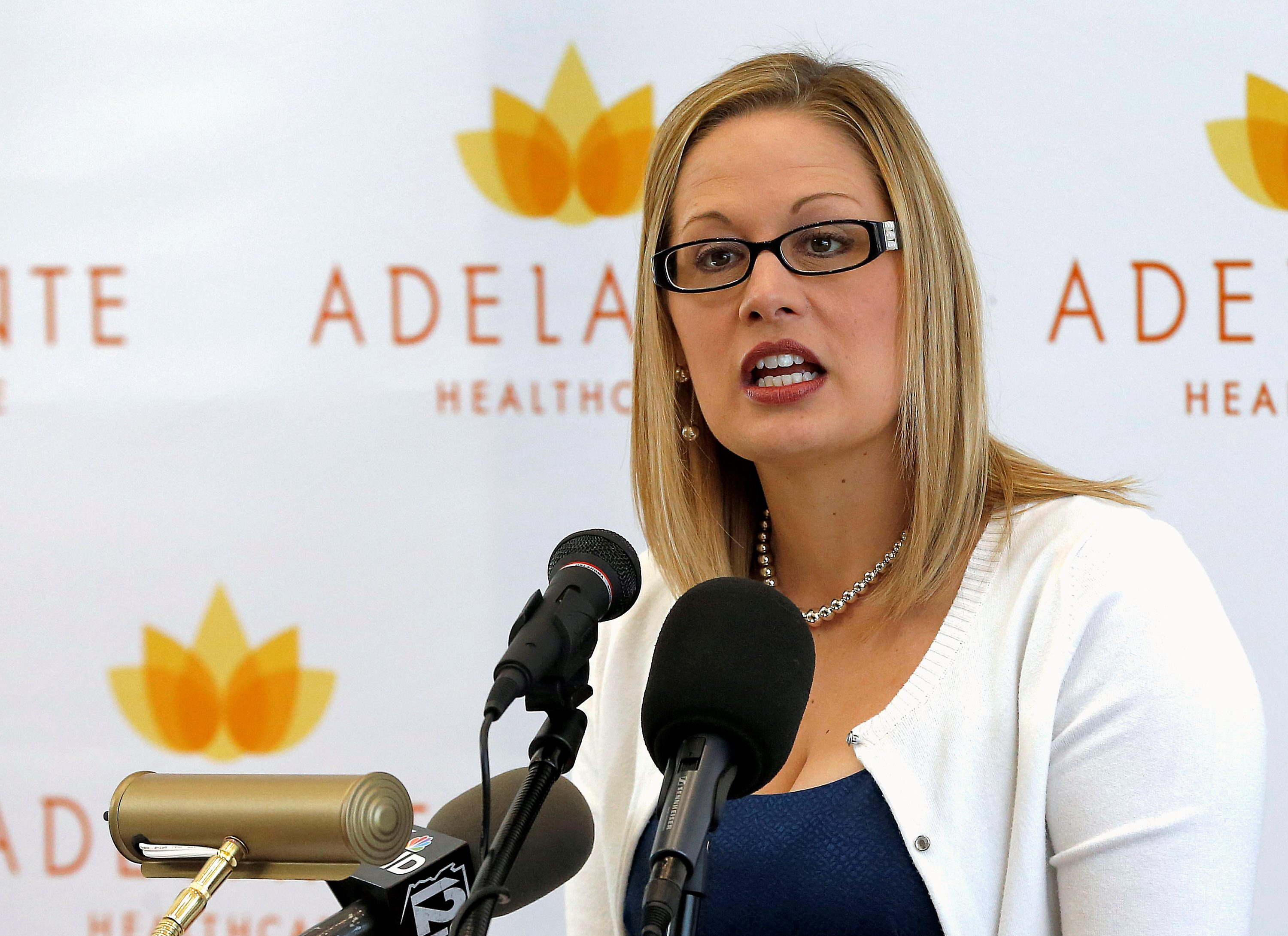 FILE - In this Aug. 20, 2013 file photo, U.S. Rep. Kyrsten Sinema, D-Ariz., speaks in Tempe, Ariz. Sinema has been the subject of speculation since Rep. Ed Pastor, D-Ariz., announced he was retiring after 23 years serving his solidly Democratic south Phoenix district. Sinema's campaign and political consultants aren't addressing questions as to whether she'll jump districts. (AP Photo/Matt York, File)