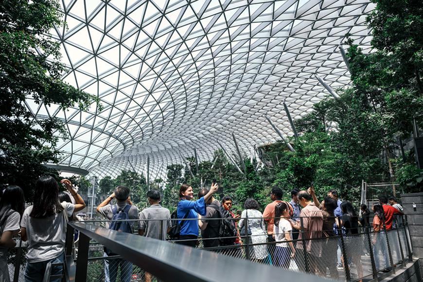 Tourist takes photo at The HSBC Rain Vortex