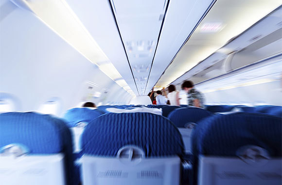 Sit in an Aisle Seat Within Five Rows of an Exit