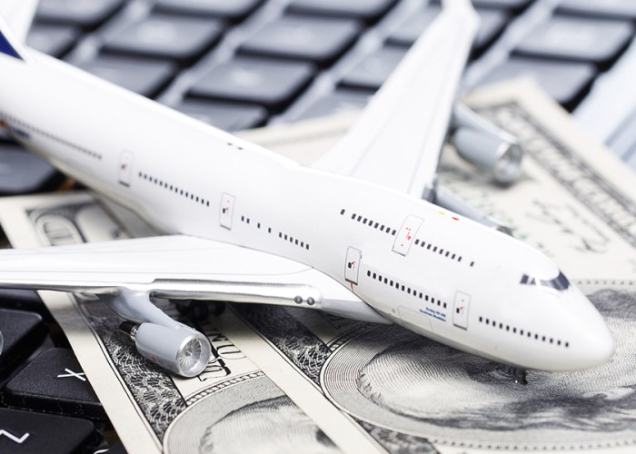 Airplane and Cash on Keyboard Airline Fees