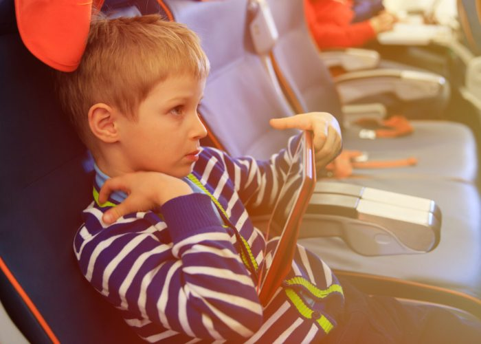 child on plane for airline family seating.