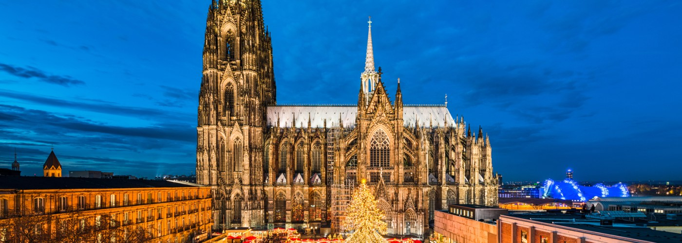 german christmas market aerial shot with stalls and church