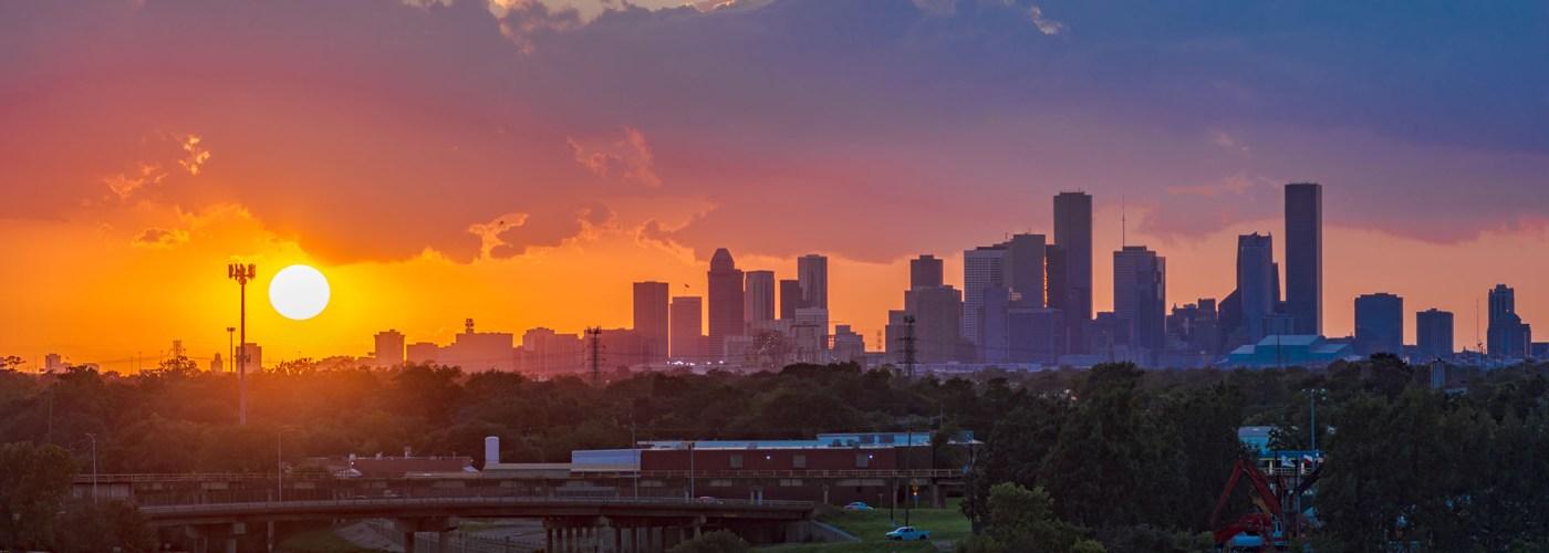 sunset over houston skyline.