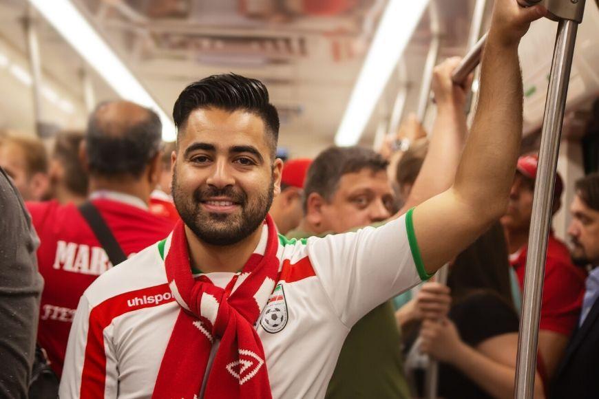 man in sport team shirt on subway.