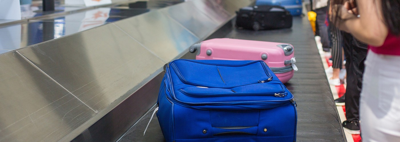 suitcases on baggage carousel.