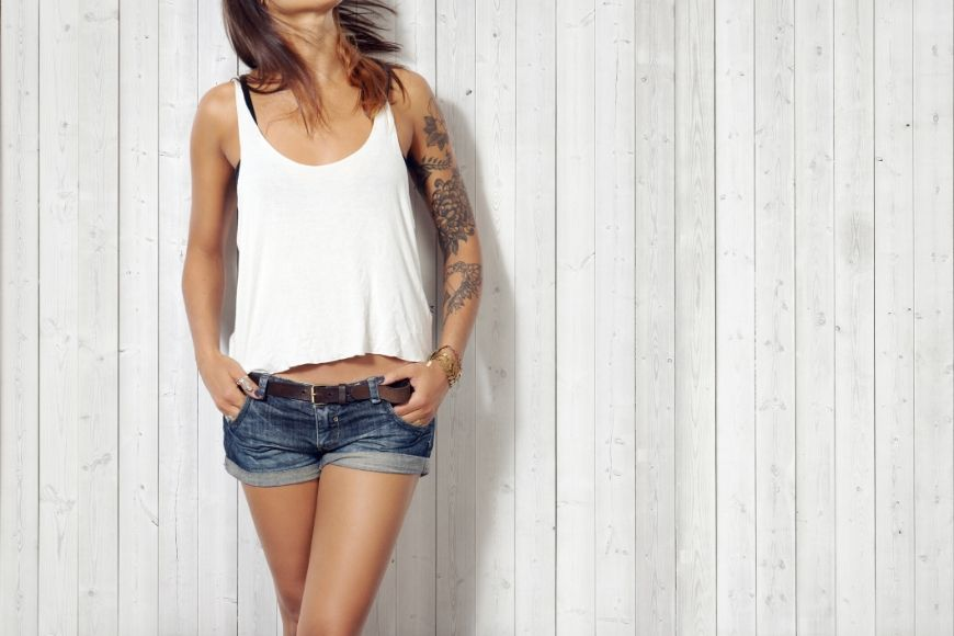 woman in shorts and tank top.