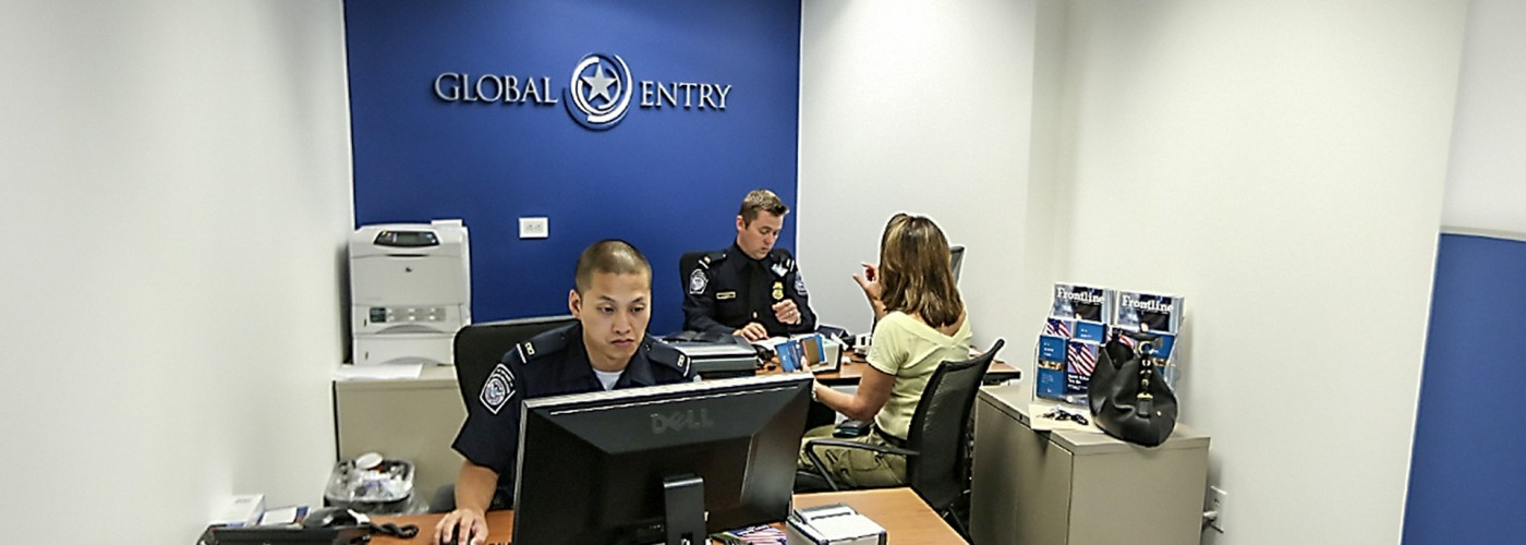 A CBP officer collects information from an enrollee during a Global Entry interview at the Ronald Reagan building.