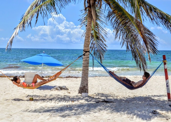 two people hanging on hammocks in mexico