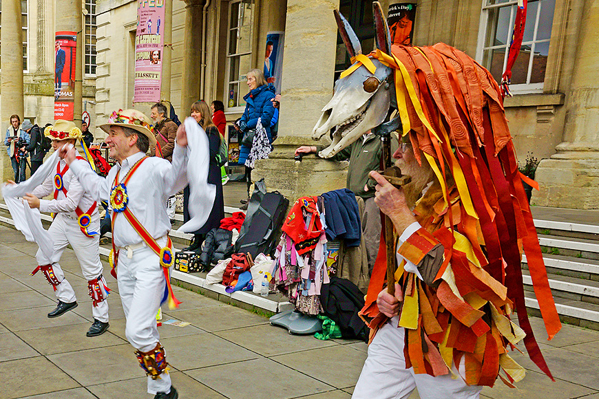 The gloucestershire morris men dancing outside the subscription rooms, with mari lwyd