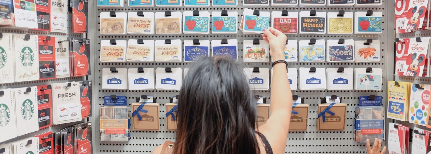 a-young-millennial-woman-shopping-for-the-right-gift-card-gift-and-present-at-the-store