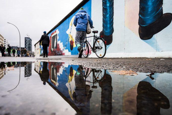 reflection of berlin wall art installation