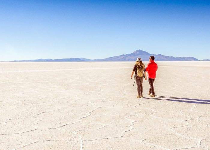 couple-walking-salt-flats-bolivia